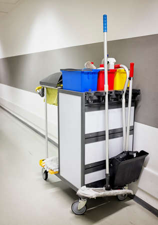 cleaning trolley (service cart) in front of wall