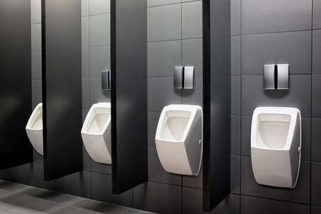 modern public restroom - urinals in a row photo