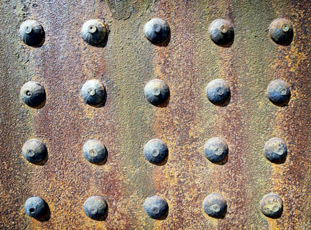 rusty iron background with rivets photo