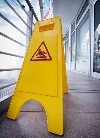 caution wet floor sign at a corridor photo