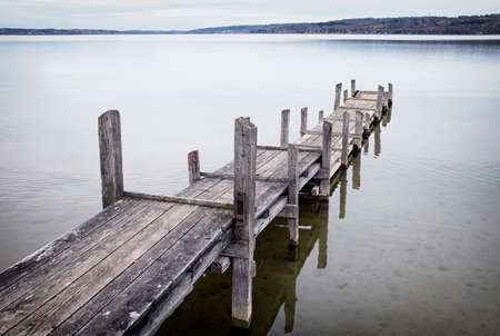 old wooden jetty at a lake photo