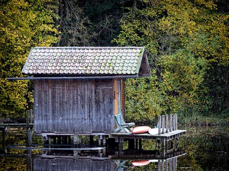fishing cabin: old fishing hut at a lake