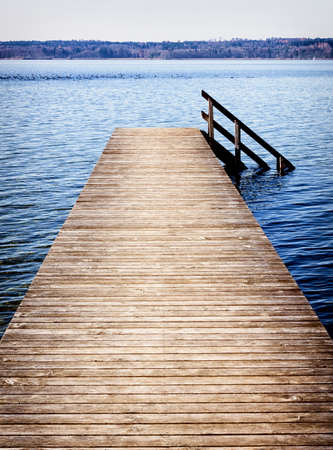the bigger picture: old wooden jetty at a lake Stock Photo
