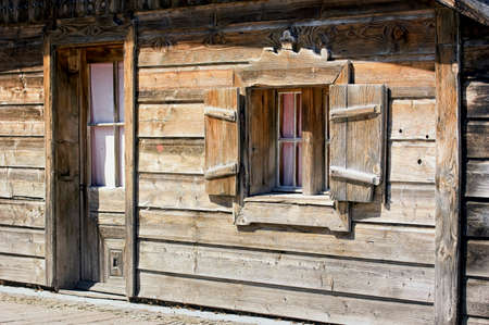building feature: facade of an old log cabin Stock Photo