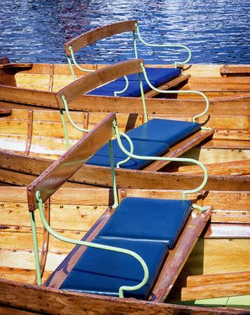 rowboats: seats of old wooden rowboats Stock Photo