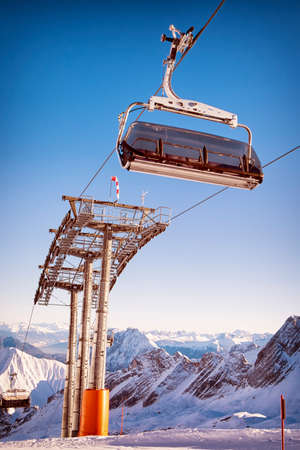 mountains with modern ski lift chair photo