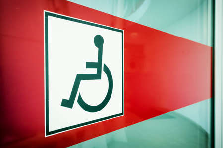 disabled sign at a restroom door photo