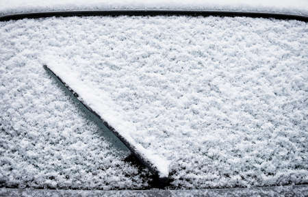 windscreen wiper: frosted windshield at winter  - close up Stock Photo