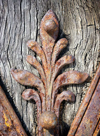 old rusty ornament at a historic door photo