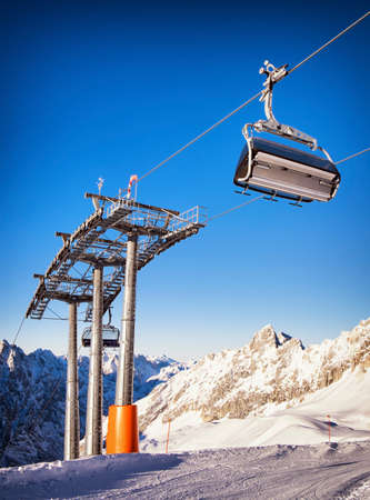 mountains with modern ski lift chair photo