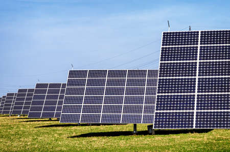 modern Solar Panels in front of blue sky photo