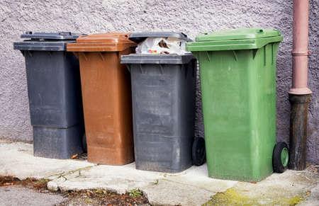 modern garbage bins at a sidewalk