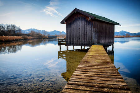 wooden hut: old wooden hut at a lake