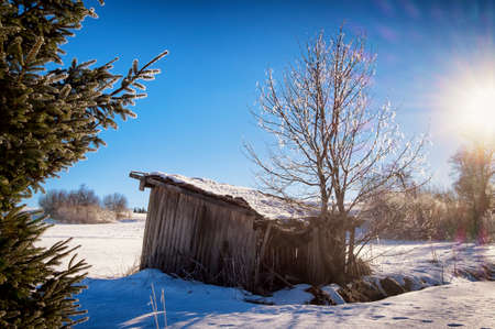 old house at the european alps in winter photo