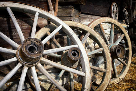 wagon: old wagon wheels at a farm Stock Photo