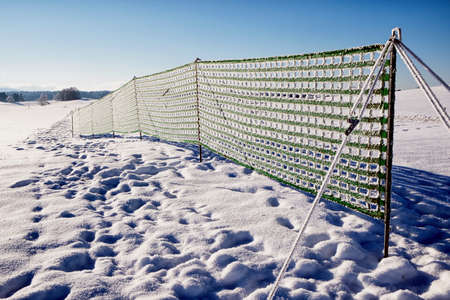 snowbank: fence against snowdrift at the alps