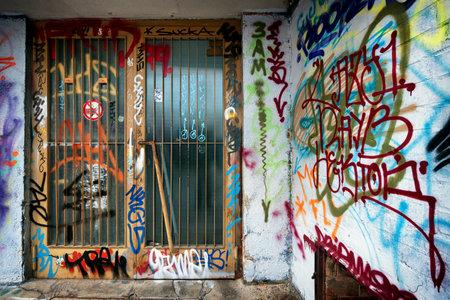 graffiti at an entrance of a plattenbau