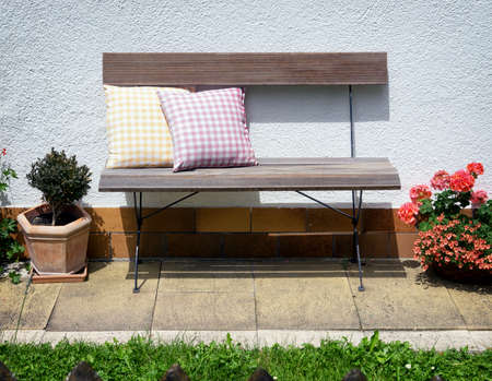 old wooden park bench and cushions photo