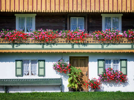 typical old farmhouse at the european alps Standard-Bild
