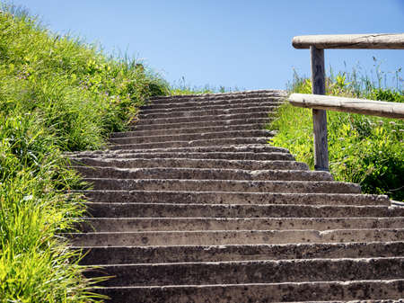 new path: old steps at a meadow Stock Photo