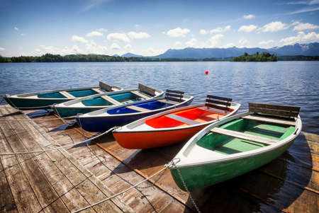 row boats at a lake photo