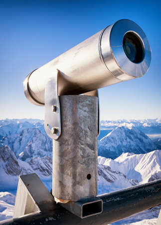 operated: coin operated binoculars at a observation point - european alps
