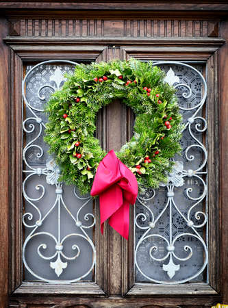 christmas wreath at a historic door photo