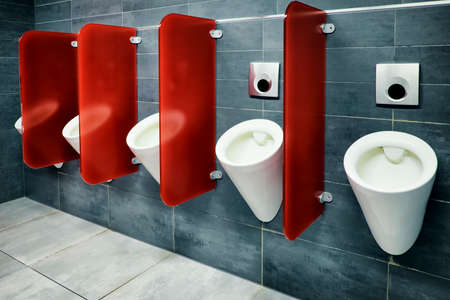 modern public restroom - row of urinals photo