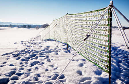fence against snowdrift at the alps photo