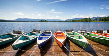 row of boats at a lake photo
