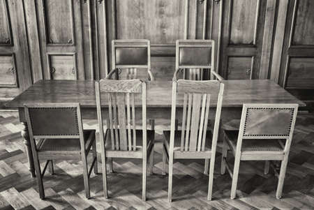 old wooden table and chairs photo