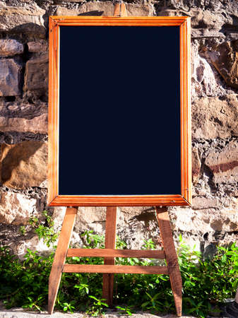 brick background: old wooden black board with space for text Stock Photo