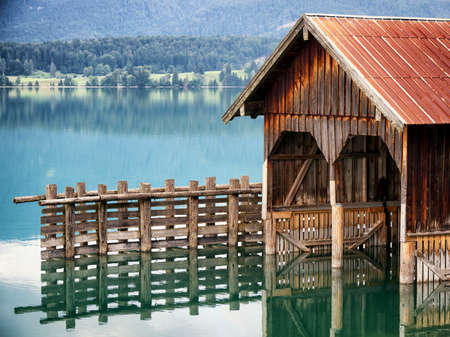 old boathouse at a lake photo
