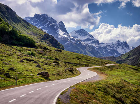 winding road: country road at the european alps Stock Photo