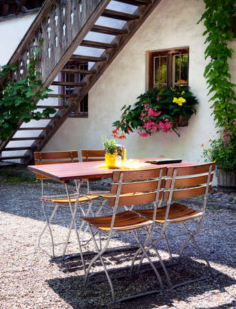 folding chair: folding chair and table at a patio