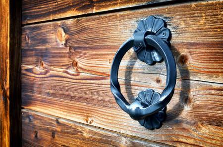 front door: old doorknocker at a historic front door