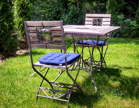 folding chair and table at a patio photo