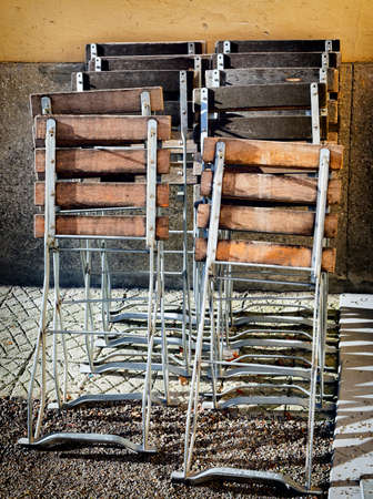 old folding chairs at a wall