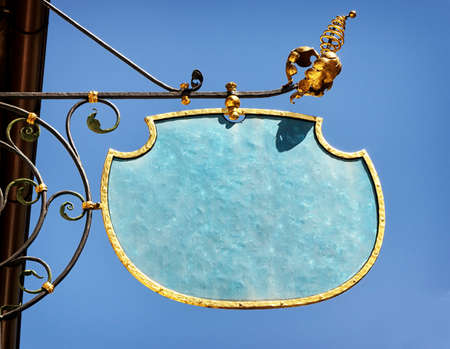 beautiful old store sign in front of sky Stock Photo