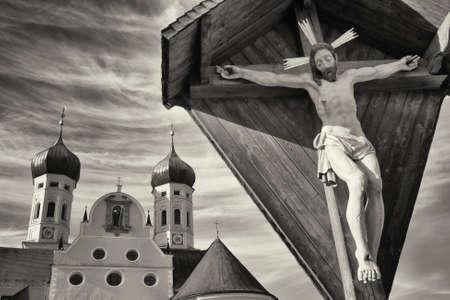 wayside: famous church in benediktbeuern - bavaria - and a historic wayside cross