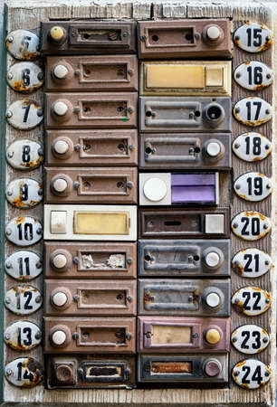 rundown old bell buttons at a wall Stock Photo