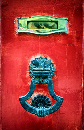 old mail slot at a door photo