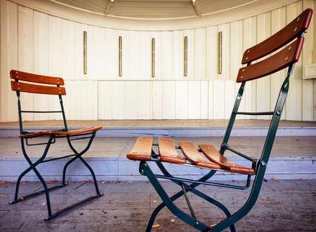 pavillion: two folding chairs at a pavillion