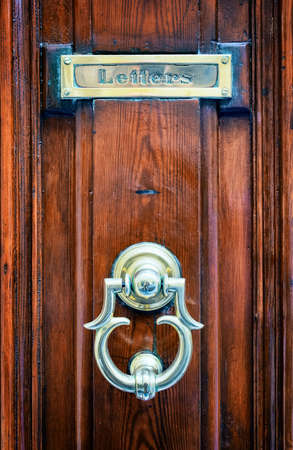mail slot: old mail slot at a door Stock Photo