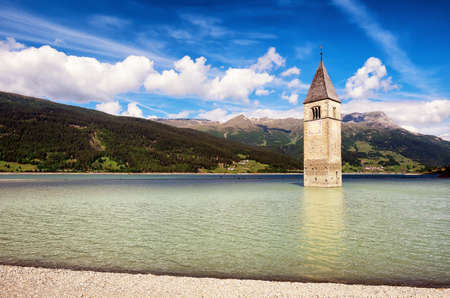 campanile: famous historic bell tower at the reschenpass - italy