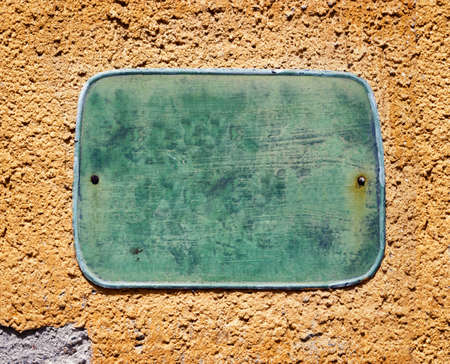 numberplate: blank sign at a wall - background with space for text
