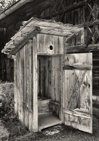 outhouse: old wooden outhouse at a farm