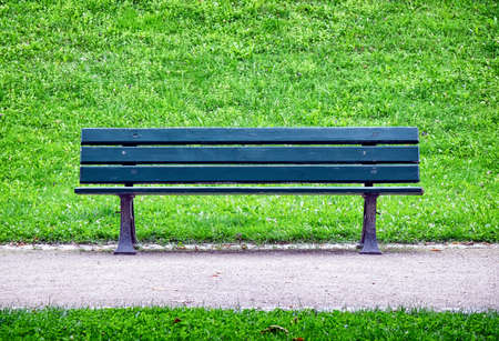 wooden park bench at a park photo