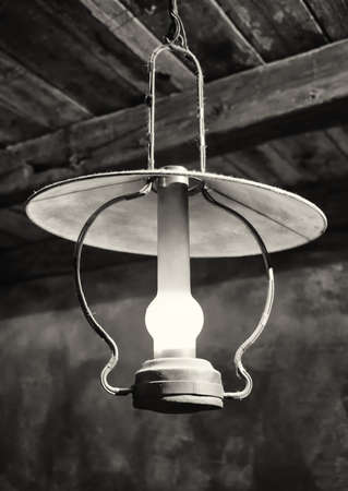 oillamp: old petroleum lamp  at a stable Stock Photo