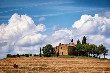 vibrant cottage: haybales at a field  tuscany  italy
